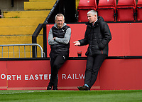 Blackpool manager Neil Critchley, left, and Lincoln City's director of football Jez George<br /> <br /> Photographer Andrew Vaughan/CameraSport<br /> <br /> The EFL Sky Bet League One - Saturday 10th April 2021 - Lincoln City v Blackpool - LNER Stadium - Lincoln<br /> <br /> World Copyright © 2021 CameraSport. All rights reserved. 43 Linden Ave. Countesthorpe. Leicester. England. LE8 5PG - Tel: +44 (0) 116 277 4147 - admin@camerasport.com - www.camerasport.com