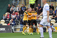 Joe Pigott of Newport (centre) celebrates after scoring his side's second goal. Skybet football league two match, Newport county v AFC Wimbledon at Rodney Parade in Newport, South Wales on Saturday 27th Sept 2014<br /> pic by Mark Hawkins, Andrew Orchard sports photography.