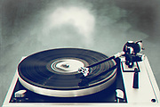 70s record player with spinning LP record - monochrome photograph with anaglyphic effect and textures