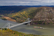 Bear Mountain, New York  - A tugboat pushes barges north on the Hudson River by the Bear Mountain Bridge on Oct. 24, 2014.