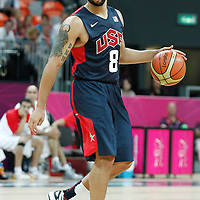 31 July 2012: USA Deron Williams brings the ball upcourt during 110-63 Team USA victory over Team Tunisia, during the men's basketball preliminary, at the Basketball Arena, in London, Great Britain.