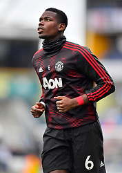 Manchester United's Paul Pogba warms up ahead of the Premier League match at the John Smith's Stadium, Huddersfield.