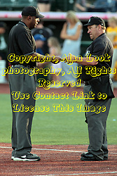 26 July 2014:   Umpires Joe Harris and Steve Dunahue. during a Frontier League Baseball game between the Lake Erie Crushers and the Normal CornBelters at Corn Crib Stadium on the campus of Heartland Community College in Normal Illinois