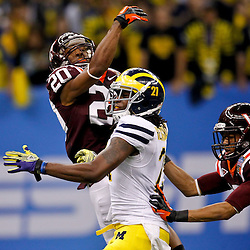 January 3, 2012; New Orleans, LA, USA; \Virginia Tech Hokies cornerback Jayron Hosley (20) defends against Michigan Wolverines wide receiver Junior Hemingway (21) on a pass during the third quarter of the Sugar Bowl at the Mercedes-Benz Superdome.  Mandatory Credit: Derick E. Hingle-US PRESSWIRE