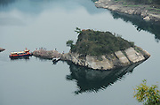 CHONGQING, CHINA - MARCH 16: (CHINA OUT) <br /> <br /> Turtle-shaped Rock Appears In The Three Gorges<br /> <br /> Photo shows a large rock in the shape of a turtle at The Three Gorges of the Yangtze River on March 16, 2015 in Chongqing, China. The rock, actually a part of a mountain, surfaced recently after The Three Gorges Dam discharged more water to downstream areas in spring. And it attracts a large number of tourists.<br /> ©Exclusivepix Media