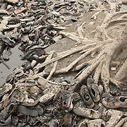 Discarded shoes. A visit to one of the main garbage dump. With 15 millions population in 2019 and growing, the city of Calcutta is a typical case of expansion through uncontrolled urbanization.