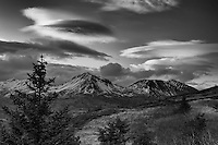 Lenticular clouds form over Three Sisters in Kodiak, Alaska