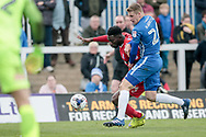 Scott Harrison (Hartlepool United) and Jabo Ibehre (Carlisle United) during the EFL Sky Bet League 2 match between Hartlepool United and Carlisle United at Victoria Park, Hartlepool, England on 14 April 2017. Photo by Mark P Doherty.