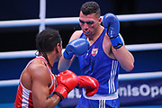 Victor Schelstraete of Belgium (left) and Ahmed Hagag of Austria  compete in the Men's Heavyweight preliminaries during The Road to Tokyo European Olympic Boxing Qualification, Sunday, March 15, 2020, in London, United Kingdom. (Mitchell Gunn-ESPA-Images/Image of Sport)