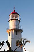 The rising sun hits Diamond Head Lighthouse in Hawaii.