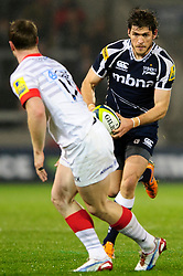 Sale Outside Centre (#13) Corne Uys runs at Saracens Winger (#11) James Short during the first half of the match - Photo mandatory by-line: Rogan Thomson/JMP - Tel: Mobile: 07966 386802 16/11/2012 - SPORT - RUGBY - Salford City Stadium - Eccles. Sale Sharks v Saracens - LV= Cup Round 2