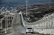 Border Patrol monitering the area between Mexico and the US Border fence.
