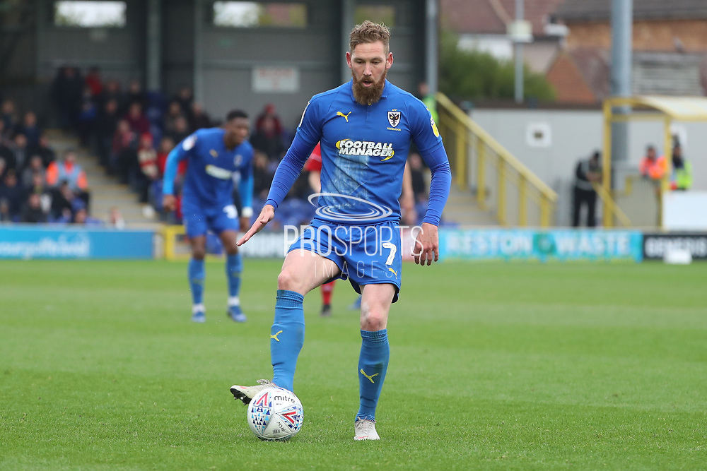 AFC Wimbledon midfielder Scott Wagstaff (7) controlling the ball during the EFL Sky Bet League 1 match between AFC Wimbledon and Accrington Stanley at the Cherry Red Records Stadium, Kingston, England on 6 April 2019.