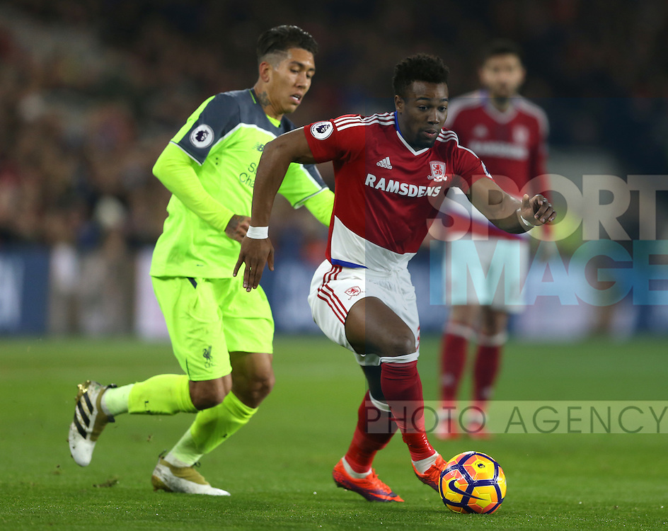 Adama Traore of Middlesbrough skips past Roberto Firmino of Liverpool during the English Premier League match at the Riverside Stadium, Middlesbrough. Picture date: December 14th, 2016. Pic Simon Bellis/Sportimage