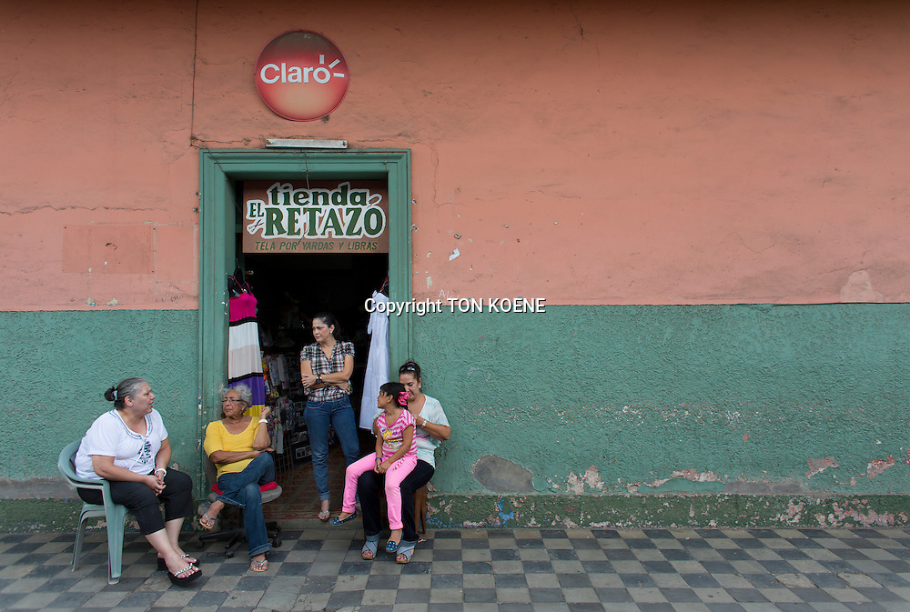 family in front of their house in nicaragua