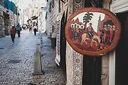 Jerusalem - October 20, 2010: A painting of Jesus riding a donkey hangs outside a shop on the Via Dolorosa in Jerusalem's Old City