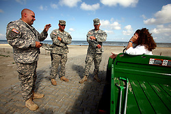 21 May 2010. Grand Isle, Lafourche Parish, Louisiana. .BP Macondo Well disaster. Soldiers from the Louisiana National Guard discuss logistics with the park manager at Grand Isle state park. Authorities closed the beach as oil washes ashore in greater concentrations than previously seen on the once pristine beaches of Grand Isle. The economic and environmental impact is devastating with shrimp boats tied up, vacation rentals and charter boat fishing trips cancelled as police chase tourists from the beaches just two hours drive from New Orleans..Oil from the Deepwater Horizon catastrophe is evading booms laid out to stop it thanks in part to the dispersants which means the oil travels at every depth of the Gulf and washes ashore wherever the current carries it. .Photo credit; Charlie Varley.