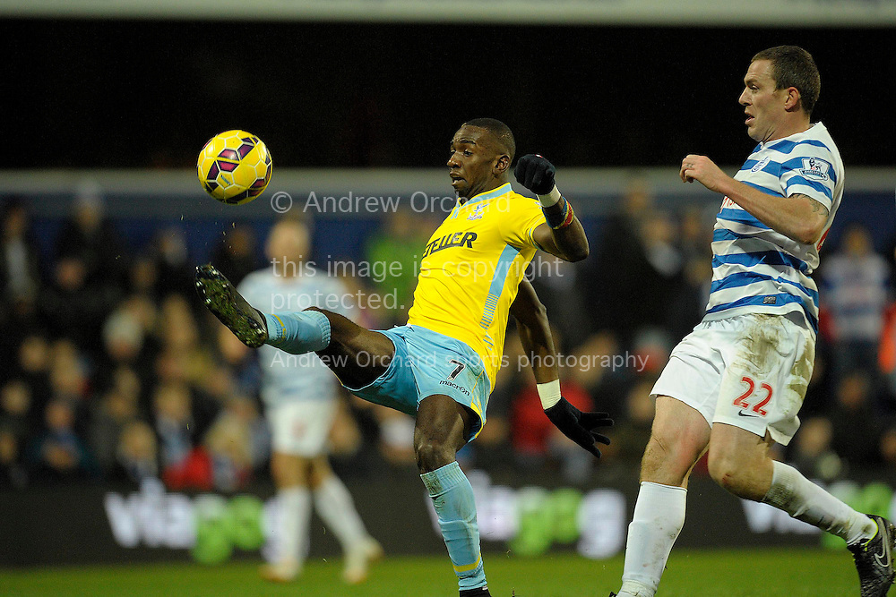 Yannick Bolasie of Crystal Palace attempting to chip the ball. Barclays Premier league match, Queens Park Rangers v Crystal Palace at Loftus Road in London on Sunday 28th December 2014.<br /> pic by John Patrick Fletcher, Andrew Orchard sports photography.