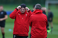 Neil Jenkins, the Wales rugby assistant coach (l) during the Wales rugby team training session at the Vale Resort Hotel in Hensol, near Cardiff , South Wales on Thursday  16th November 2017.  the team are preparing for their Autumn International series match against Georgia this weekend.   pic by Andrew Orchard