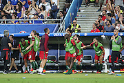 The Portugal substitutes and Portugal Forward Cristiano Ronaldo jump up after they thought they had scored during the Euro 2016 final between Portugal and France at Stade de France, Saint-Denis, Paris, France on 10 July 2016. Photo by Phil Duncan.