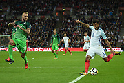 England defender Ryan Bertrand puts in a cross watched by Slovenia's Aljaz Struna during the FIFA World Cup Qualifier match between England and Slovenia at Wembley Stadium, London, England on 5 October 2017. Photo by Martin Cole.