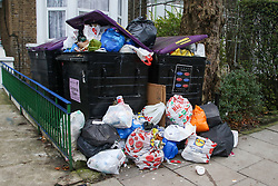 © Licensed to London News Pictures. 28/12/2020. London, UK. Bags of rubbish are gathered in a front garden in north London after the festive period. Photo credit: Dinendra Haria/LNP