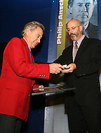 28 August 2006: Philip Anschutz (l) is presented with his Hall of Fame jacket, plaque, and ring by HOF president Will Lunn (r) upon his induction. The National Soccer Hall of Fame Induction Ceremony was held at the National Soccer Hall of Fame in Oneonta, New York.