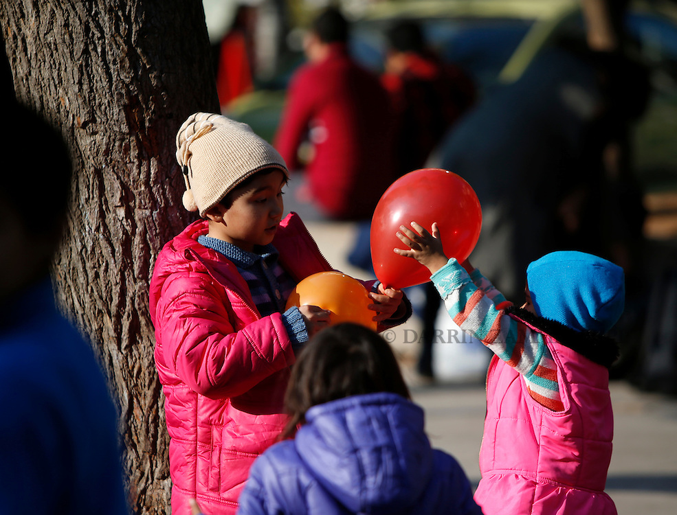 Migrant children play with balloons in Victoria Square in central Athens, Greece, January 27, 2016. <br /> Photo: Darrin Zammit Lupi