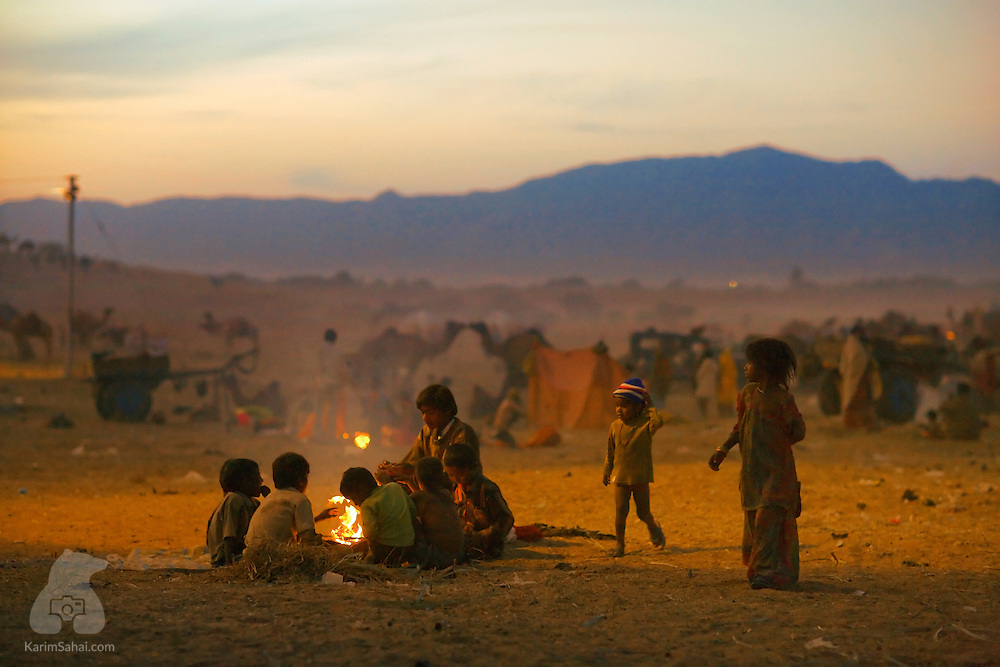 A group of orphans gather around a fire in the Thar desert, Rajasthan, India.