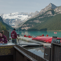 A concessionaire rents canoes to tourists visiting Lake Louise in Banff National Park, Alberta, Canada.