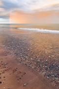 Spectacular sunrise with colorful rain clouds and rainbow over dunes and baltic sea, near Ventspils, Kurzeme, Latvia Ⓒ Davis Ulands   davisulands.com