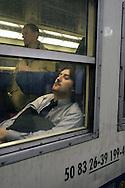 Milano, Northern Railway: a man sleeping in a wagon train.
