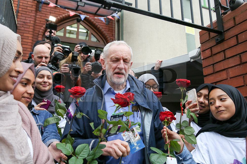 © Licensed to London News Pictures. 03/03/2019. London, UK. Muslim girls hand red roses to the Labour leader Jeremy Corbyn as he arrives at Finsbury Park Mosque in North London for the fourth Visit My Mosque Day. Over 250 mosques open their doors to non-Muslim guests and visitors on the fourth Visit My Mosque Day. This year the national event also encourages mosques to support Keep Britain Tidy's Great British Spring Clean campaign with many already taking part in cleaning their communities. Photo credit: Dinendra Haria/LNP