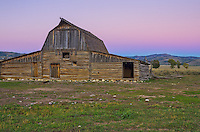 After the sun went down, the sky turned pink in the east beyond the Moulton Barn. The barn is all that remains of a homestead first settled by the Moulton family over 100 years ago.