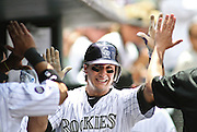 SHOT 6/10/10 2:12:00 PM - The Colorado Rockies Troy Tulowitzki high fives teammates in the dugout after scoring a run against the Houston Astros during their game at Coors Field in downtown Denver, Co. The Astros won the game 5-4.  (Photo by Marc Piscotty / © 2010)