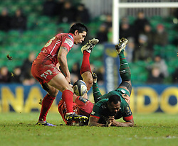 Leicester Tigers centre, Vereniki Goneva is tackled by Scarlets number 8, Rob McCusker  - Photo mandatory by-line: Dougie Allward/JMP - Mobile: 07966 386802 - 16/01/2015 - SPORT - Rugby - Leicester - Welford Road - Leicester Tigers v Scarlets - European Rugby Champions Cup