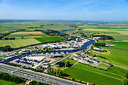 Nederland, Utrecht, Eemnes, 09-06-2016;  Eembruge met riviertje de Eem en de A1 in de voorgrond. Arkemheen-Eemland.  <br /> Polder landscape between Utrecht and Amsterdam.<br /> <br /> luchtfoto (toeslag op standard tarieven);<br /> aerial photo (additional fee required);<br /> copyright foto/photo Siebe Swart