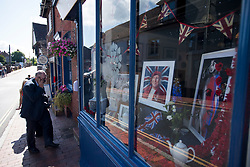 © Licensed to London News Pictures. 10/07/2020. London, UK. Pictures of Dame Vera Lynn in a window display of a cafe in the town of Ditchling, East Sussex, ahead of the funeral of Dame Vera Lynn. The 'Forces' Sweetheart', who died last month aged 103, was famous for singing performances during WW2, which helped raise morale amongst troops abroad. Photo credit: Ben Cawthra/LNP