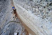 "Kevin Jorgeson and Charlie Barrett climbing the Sierra testpiece steep crack route ""Grand Illusion"" (5.13b/c), at Sugar Loaf, near Lake Tahoe California"