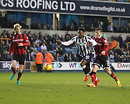 Fred Onyedinma of Millwall and Matthew Sadler of Shrewsbury Town during the Sky Bet League 1 match at The Den, London<br /> Picture by Richard Brooks/Focus Images Ltd 07947656233<br /> 10/12/2016