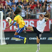 Brazil defender Rilany (2) and U.S. midfielder Heather O'Reilly (9) fight for the ball during a women's soccer International friendly match between Brazil and the United States National Team, at the Florida Citrus Bowl  on Sunday, November 10, 2013 in Orlando, Florida. The U.S won the game by a score of 4-1.  (AP Photo/Alex Menendez)