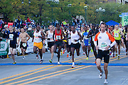 This image of the Elite Runners at the start of the Quad Cities Marathon shows the determination of this year's marathon runners. The photo shows the first few seconds of what would become a difficult race for some in this important marathon.
