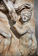 Close up of a Roman Sebasteion relief  sculpture of a prisoner of  Emperor Claudius as God of sea and land,  Aphrodisias Museum, Aphrodisias, Turkey.  Against a grey background.<br /> <br /> The Emperor as god Claudius strides forward in a divine epiphany, drapery billowing around his head. He receives a cornucopia with fruits of the earth from a figure emerging from the ground, anda ship's steering oar from a marine tritoness with fish legs. The idea is clear: the god-emperor guarantees the prosperity of land and sea. The relief is a remarkable local visualisation - elevated and panegyrical - of the emperor's role as a universal saviour and divine protector. .<br /> <br /> If you prefer to buy from our ALAMY STOCK LIBRARY page at https://www.alamy.com/portfolio/paul-williams-funkystock/greco-roman-sculptures.html . Type -    Aphrodisias     - into LOWER SEARCH WITHIN GALLERY box - Refine search by adding a subject, place, background colour, museum etc.<br /> <br /> Visit our ROMAN WORLD PHOTO COLLECTIONS for more photos to download or buy as wall art prints https://funkystock.photoshelter.com/gallery-collection/The-Romans-Art-Artefacts-Antiquities-Historic-Sites-Pictures-Images/C0000r2uLJJo9_s0