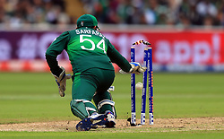 Pakistan's Sarfaraz Ahmed removes the bails to run out New Zealand's Colin de Grandhomme (not in picture) during the ICC Cricket World Cup group stage match at Edgbaston, Birmingham.