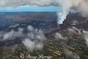 Aerial view of Kilauea Volcano east rift zone erupting hot lava from Fissure 8 in the Leilani Estates residential subdivision near the town of Pahoa. Fissure 8 has built a cinder cone over 50m high around itself. The lava drains downhill toward Kapoho, Puna District, Hawaii Island ( the Big Island ), Hawaiian Islands, U.S.A.