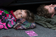 Environmental activists from Extinction Rebellion use a lock-on under a vehicle to block a road in the Covent Garden area during the first day of Impossible Rebellion protests on 23rd August 2021 in London, United Kingdom. Extinction Rebellion are calling on the UK government to cease all new fossil fuel investment with immediate effect.