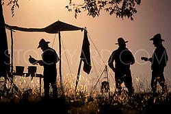 Cowboys preparing dinner on the trail