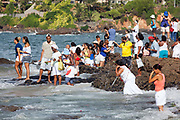 Brazilian People making offering of flowers to the sea in honour of Yemanja. February 2nd is the feast of Yemanja, a Candomble Umbanda religious celebration, where thousands of adherants visit the Rio Vermehlo Red River to pay their respects to Yemanja, the Orixa goddess of the Sea and water.