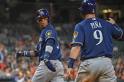 March 26, 2018 - Houston, TX, U.S. - HOUSTON, TX - MARCH 26: Milwaukee Brewers catcher Manny Pina (9) and Milwaukee Brewers infielder Orlando Arcia (3) celelbrate each scoring runs in the top of the third during the game between the Milwaukee Brewers and Houston Astros at Minute Maid Park on March 26, 2018 in Houston, Texas. (Photo by Ken Murray/Icon Sportswire) (Credit Image: © Ken Murray/Icon SMI via ZUMA Press)