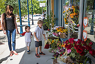 July 25, 2015 in Lafayette, Louisiana. People leaving flowrers  at a makeshift memorial outside of a store owned by one of the victims, Jillian Johnson. Two people were killed and nine wounded when a shooter identified as John Russell Houser, opened fire in The Grand 16 cinema on July 24. Houseer killed himself.